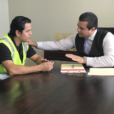Joel Herrera working with a client